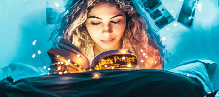 One of my favorite pictures of a girl reading Harry Potter and Harry Potter things floating around her head